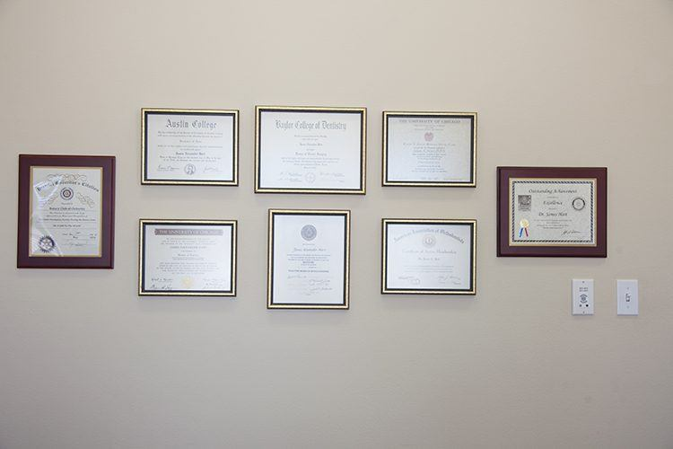Certificates and diplomas on wall