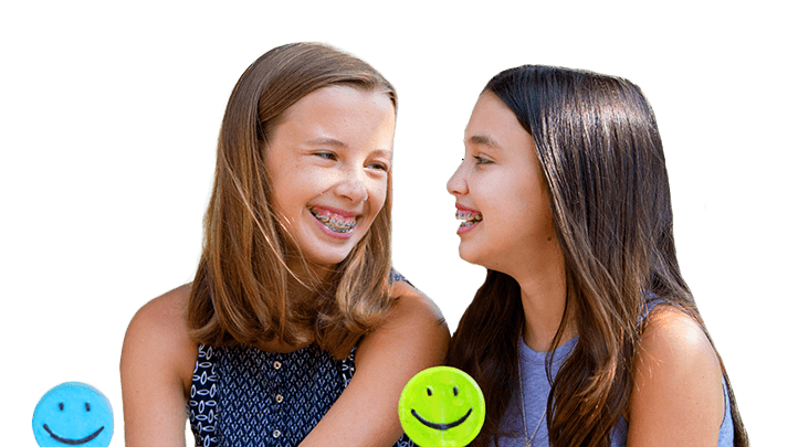 Two smiling young girls with braces