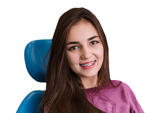 Young woman in exam chair with braces