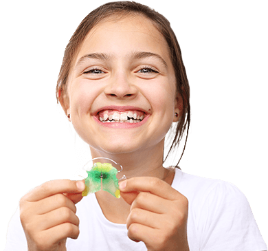 Little girl holding oral appliance