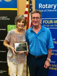 Dr. Hart and his wife holding Rotary Club Award