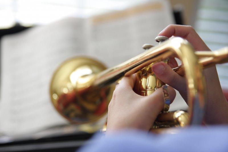 Closeup of child playing trumpet